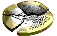 BP3XTC A one Euro coin broken into several pieces
